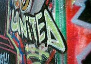 Graffiti with word 'united', close-up