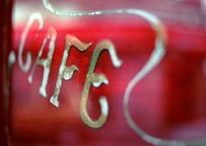 'Cafe' text on sign in window, close-up