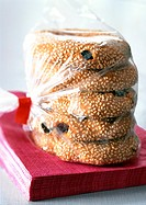 Raisin sesame cookies in plastic bag, close-up
