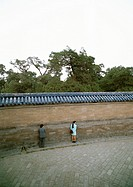 China, Beijing, Tian Tan Temple of Heaven, two people close to the Echo Wall