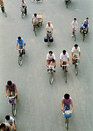 China, Beijing, people riding bicycles in street, elevated view