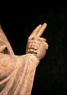 Statue, hand with two fingers making gesture, close-up