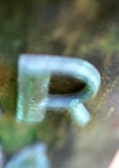 Letter R, close-up, blurred
