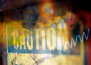 'Caution' text on sign and 'www' text, composite, close-up