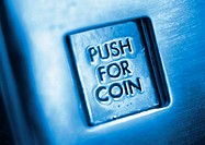 'Push for coin' button, close-up