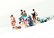Group of people on beach, blurred