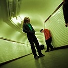 Young people standing in subway corridor