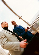 Businessmen walking together, blurred