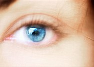 Woman´s blue eye, blurred close up