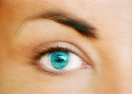 Woman´s green-blue eye, close-up, blurry