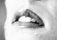 Woman´s open mouth, close up, black and white, blurred