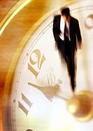 Businessman walking on clock, montage
