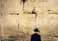 Israel, Jerusalem, man standing in front of Wailing Wall