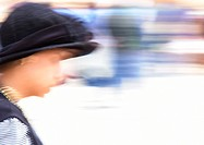 Israel, Jerusalem, woman wearing hat, blurred