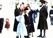 Israel, Jerusalem, people standing in street, blurred