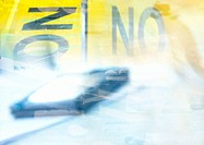 'No' typography with abstract, blurry object, yellow and light blue, montage