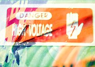 'Danger High Voltage' typographic sign, montage