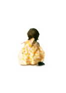 Silhouette of child sitting down, rear view, on white background, defocused