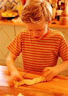 Child handling pastry dough, blurred motion