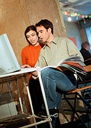 Man and woman looking at computer (thumbnail)