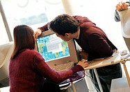 Man and woman looking at computer screen
