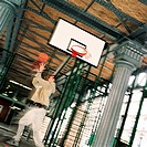 Young man playing basketball, blurred