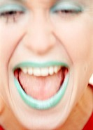 Woman with green lipstick laughing, close-up