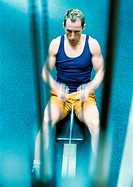 Man using rowing machine, high angle view