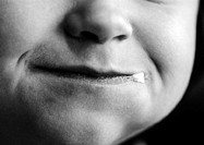 Child´s face, close-up on mouth, b&w