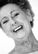 Senior woman laughing, close-up, portrait, b&amp;w
