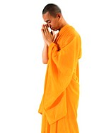 Buddhist monk standing, meditating