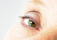 Senior woman's eye, close-up, blurred