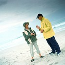 Mature couple talking on beach