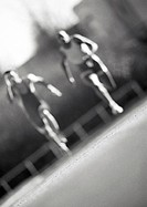 Male athletes running fast, blurred motion, b&w