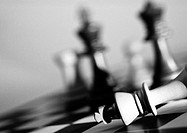 Chess pieces on chessboard, b&amp;w