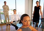 Business people in office, portrait, blurred