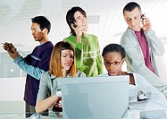 Group of people gathered around computer