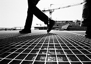 Person walking on construction site, low section