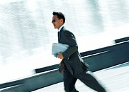 Businessman hurrying with cell phone in hand