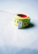 Measuring tape, close-up, blurred