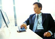 Businessman working on computer (thumbnail)