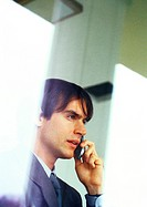 Businessman talking on cell phone, partial view, head and shoulders