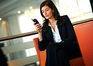 Businesswoman sitting, using cell phone