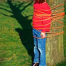 Child tied to tree