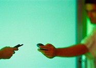 Two people holding cell phones