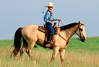 Cowgirl riding horse. Texas. USA