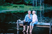 Senior couple fishing on a dock