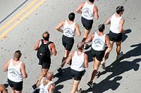 Men running in formation. Ocean Drive. Miami Beach. Florida. USA