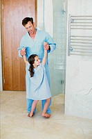 Father and daughter having fun in the bathroom