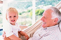 Grandad with grandson in a hammock